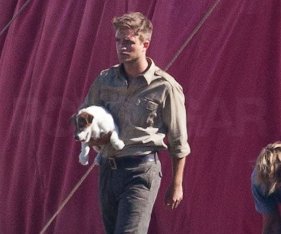 Slide Picture of Robert Pattinson With Puppy on Water For Elephants Set