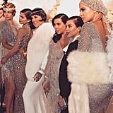 """Khloé shared a profile shot of the Gatsby squad, declaring that her shawl was faux fur. Meanwhile, she admitted her gown was inspired by Rihanna's """"naked"""" Adam Selman design at the CFDA  Fashion Awards in June 2014."""