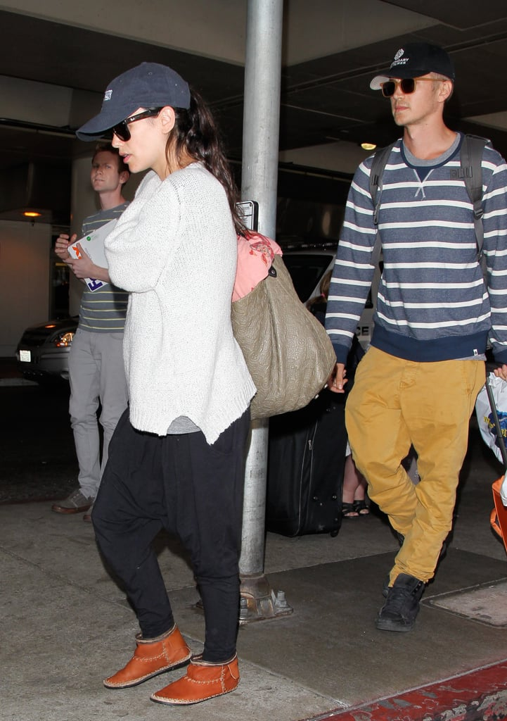 "Rachel Bilson and Hayden Christensen returned to LAX after a nearly monthlong trip to Barbados on Thursday. Rachel ditched her bikini and opted for a comfy sweater at the airport instead, adding a Skywalker hat that gave a fun nod to Hayden's role as Anakin in Star Wars: Episode II. The couple spent their tropical vacation staying superclose, snapping pictures, lounging in the sand, and even stealing a few kisses. Their Caribbean extravaganza kicked off over Memorial Day weekend, when the mom-to-be bared her belly in a Beach Riot bikini during a day on a boat as well as a black Marysia two-piece for some snorkeling. (Actress Lupita Nyong'o wore a white version of the suit in Hawaii!) News of Rachel's pregnancy made headlines late last month, and though neither Rachel nor Hayden has confirmed the news, a source close to the couple has said, ""They've both talked about this for a while and are so excited. Everyone is beyond thrilled for them."" Also, Rachel's Hart of Dixie costar Jaime King recently shared a photo of the two on Instagram, saying, ""Getting ready for Season Four of #HartOfDixie. Let's do this Bilson and baby!"" Keep reading to see Rachel and Hayden's return to LA, as well as all the sweet photos from their vacation!"