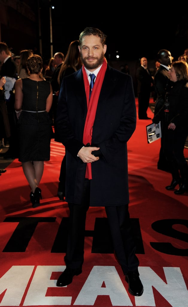 Tom kept warm with a red scarf and new facial scruff.