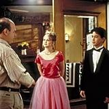 Larisa Oleynik as Bianca Stratford in a pink crop top and skirt set.