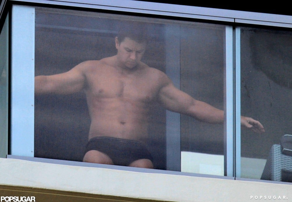 Mark Wahlberg got spray tanned on his balcony in Miami.