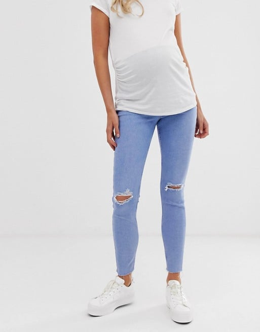 New Look Maternity over bump ripped jeans in light blue | ASOS