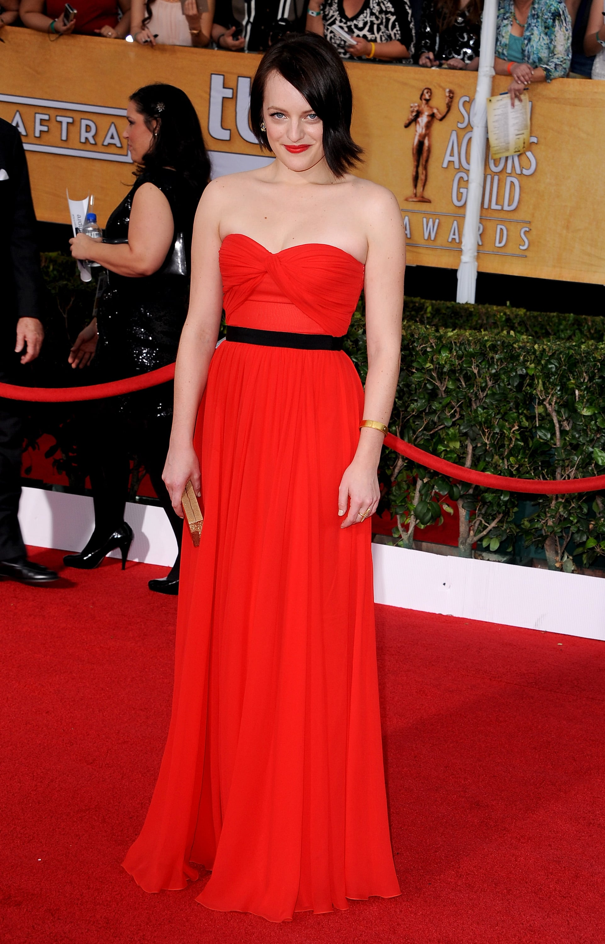 Elisabeth Moss matched her lipstick to her bright red gown.