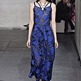The exact same shade of blue just rolled down the Roland Mouret runway, this time in the form of a floral midi stitched with swirling flowers. Kate might add cap sleeves to the piece, and perhaps style it with plain pumps.