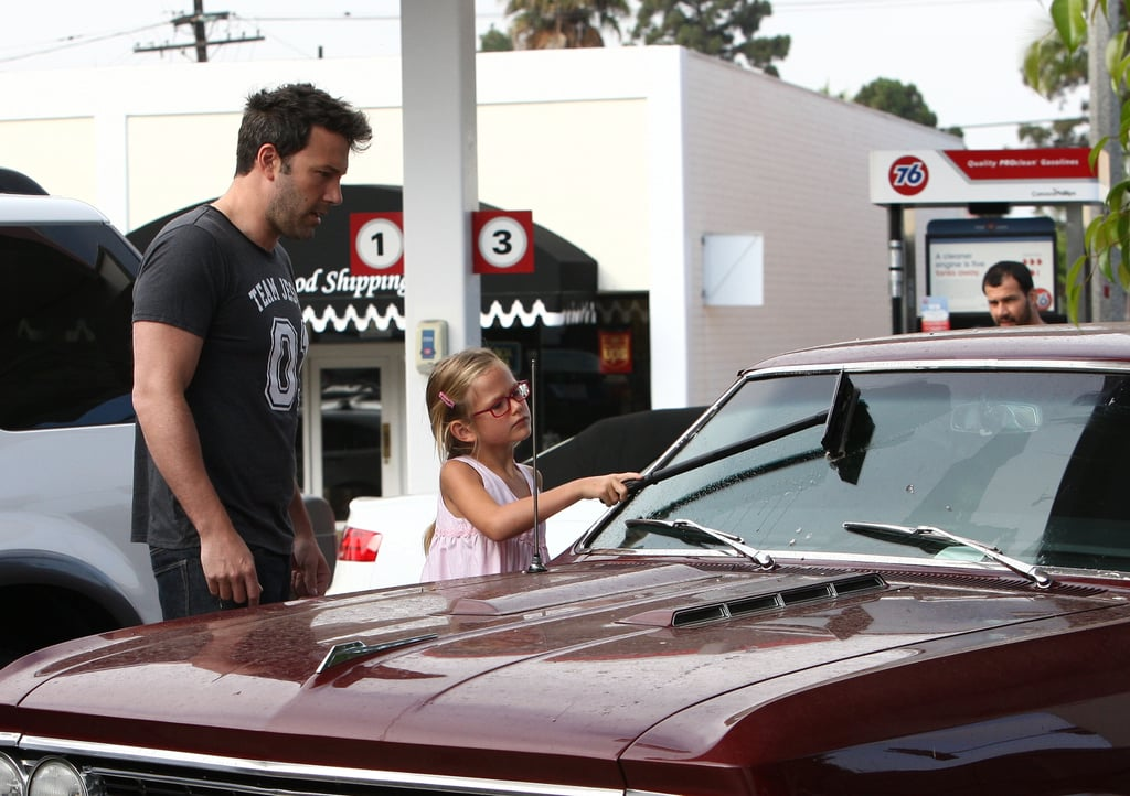 """Ben Affleck taught his daughter Violet the importance of keeping a clean windshield when they stopped by a gas station in LA's Brentwood neighborhood today. Ben, clad in a """"Team Jesus"""" t-shirt, aided his tiny helper with the squeegee while they pumped his vintage Chevy Malibu SS full of gas, and they later made a stop by Krispy Kreme donuts for a postwash treat. Ben's car appeared to be cooperating this time around, as it previously broke down on him during an outing in Pacific Palisades, CA, last month. Ben has been lying low over the past few weeks, but that doesn't mean he hasn't been busy. He attended the 2013 ESPY Awards in LA last week and recently lined up a new gig in the highly anticipated film adaptation of Gone Girl."""