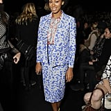 During New York Fashion Week Fall 2013, Solange Knowles showed her support for Diane von Furstenberg in a floral periwinkle blazer and matching pencil skirt by the designer. She finished off her print pairing with an orange and gray blouse and pointed yellow pumps.