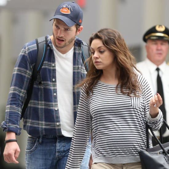 Mila Kunis Shows Baby Bump at Airport With Ashton Kutcher