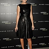 Malin Akerman stepped out in a sweet pleated BOSS Black matte leather dress and colorblock Christian Louboutin sandals.