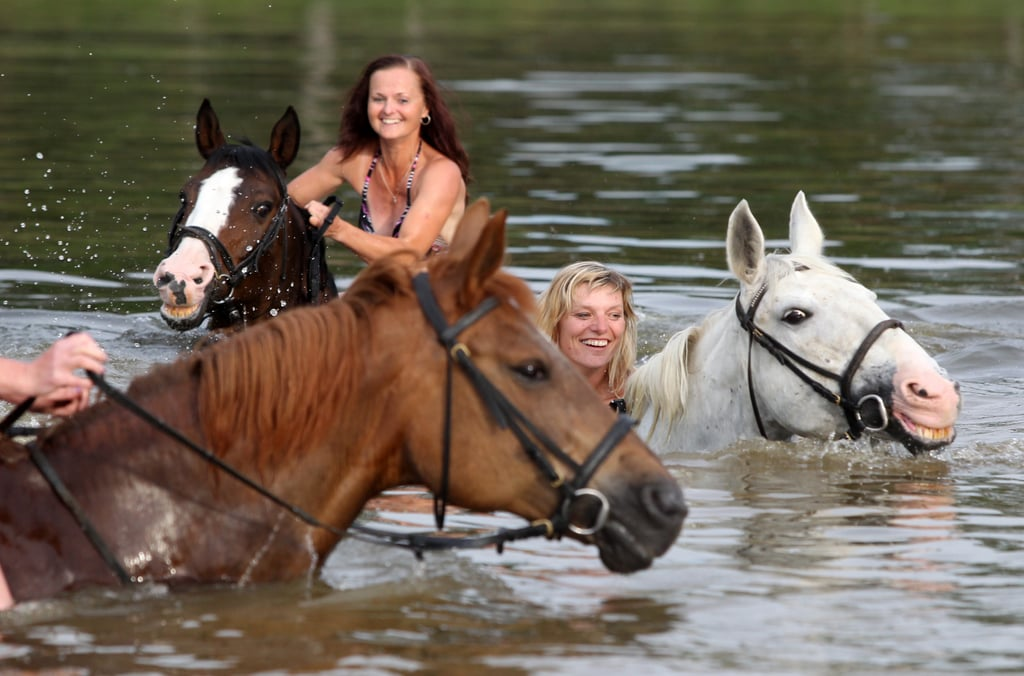 Women in Bohuslavice, Czech Republic, cooled off along with their horses in a local pond.