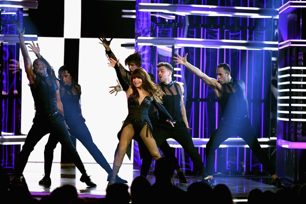 "The 2019 Billboard Music Awards was all about nostalgia, and we love it! While performances from artists like the Jonas Brothers and Kelly Clarkson featured their latest hits, other artists took us on a journey through their greatest hits and had us simmering in our feelings over yesteryear.  Former Billboard Icon Award winner Paula Abdul took the stage to perform a six-minute medley of her classic songs and showed that she's just as fierce as she was when they debuted on the charts! Abdul showed off her svelte figure in an all-black cabaret outfit, tap-dancing her way across the stage to ""Straight Up"" before she launched into ""Vibeology"" and ""Opposites Attract"" featuring MC Skat Kat himself! At one point, the 56-year-old literally jumped off a platform into a sea of men, so she's officially checked off several items on my bucket list. The performance follows the former American Idol judge's announcement that she'll be making her home in Las Vegas for a new residency, Paula Abdul: Forever Your Girl, starting on Aug. 13. The announcement and BBMAs performance coincide with the 30th anniversary of her Billboard hit ""Straight Up"" and the 31st anniversary of her album Forever Your Girl. So if you're worried about catching another epic Abdul performance, don't be. She won't be going anywhere anytime soon!  Watch her strut her stuff on stage ahead, and then keep scrolling for a closer look at her performance in photos.      Related:                                                                                                           Mariah Carey's Emotional Billboard Music Awards Performance Was a Love Letter to Her Lambs"