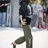 For an athleisure vibe that's still polished, a cropped hoodie and kitten-heel mules feel easy, yet smart.