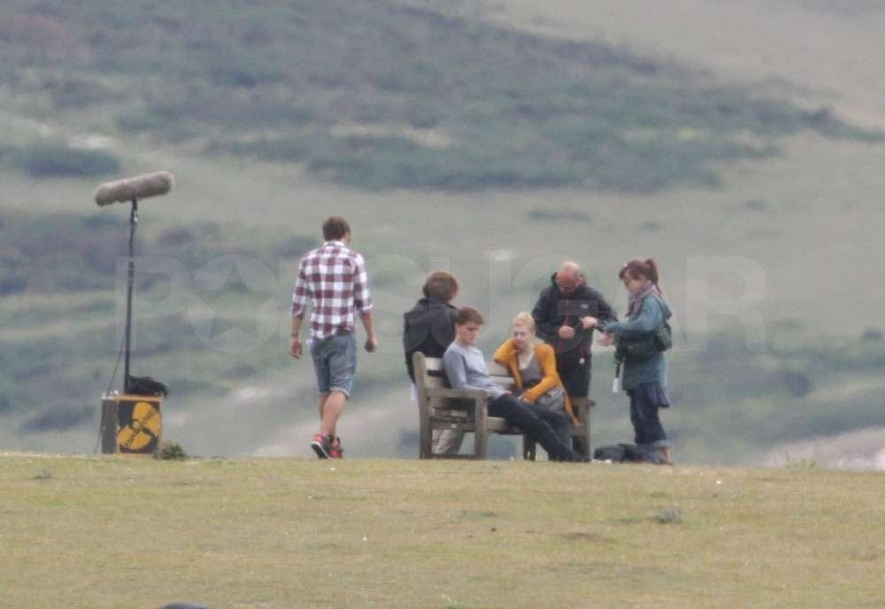 Dakota Fanning and Jeremy Irvine were surrounded by crew.