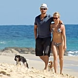 Julianne Hough and Ryan Seacrest walked on the beach.