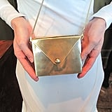 Kate gave us a sneak peek of a yet-to-be-released JewelMint box clutch — the strap is removable and can be used as a necklace and belt!