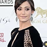 Gray eye shadow and a pinkish, nude lip paired beautifully with Emmy Rossum's elegant updo.
