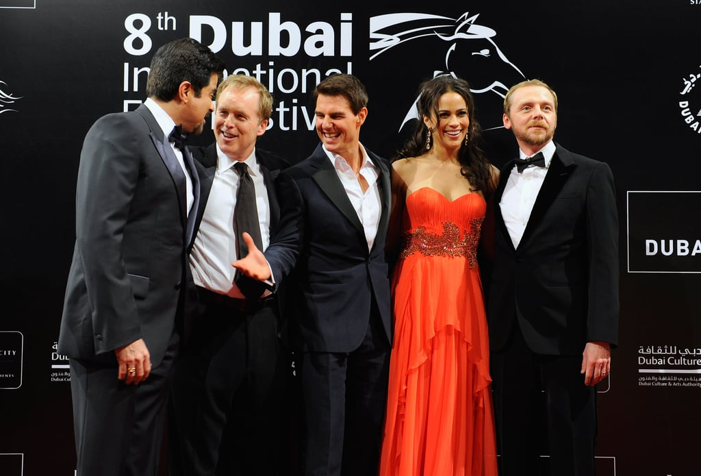 """Tom Cruise spent today in the company of his Mission: Impossible — Ghost Protocol castmates at the Dubai International Film Festival. Tom and friends Paula Patton, Simon Pegg, and Anil Kapoor began their day with a press conference then they changed into formal wear for the United Arab Emirates premiere of the film. The desert of the UAE plays a prominent backdrop in the film as does the Burj Khalifa, the tallest building in the city and the world. Tom scaled the skyscraper for a stunt and had this to say about the impressive climb. Tom said,  """"[up there] I have one little pick and one little rope, I remember just being there saying this is a moment of truth. [It's] one thing seeing it, another thing trying to accomplish [the climb].""""  The entire cast, with the exception of Jeremy Renner, is already on their way to Moscow for their next appearance with future stops expected in Mexico, Brazil, and of course the States. The fourth installment in the franchise was expected to be Tom's last as super spy Ethan Hunt, but there's growing speculation he could return. According to Jeremy, it's possible Tom might sign on for a fifth MI film pending box office success and Tom's willingness to play the role."""