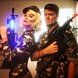 Maria Menounos and hair and makeup artist Dimitris Giannetos made their paratrooper costumes even more believable with toy guns.