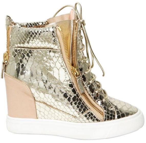 We can guarantee that these metallic wedge sneakers will sell out fast — don't miss out.  Giuseppe Zanotti Python Print Wedge Sneakers ($650)