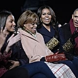Michelle accessorized her look with golden hoop earrings.
