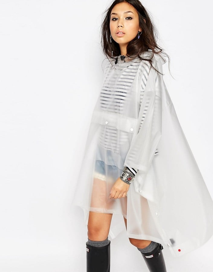 As you reach for the dry shampoo and your go-to hangover cure when packing this festival season, don't forget another key essential: the rain mac. If you're heading to a British festival, it's very likely it may just be your BFF for the long weekend. This BFF doesn't have to be ugly either, thanks to Missguided, Topshop, and Hunter, you'll be doing the rain dance so you can reach for your new holographic getup. Read on for 23 drizzle-fighting jackets then be sure to complete your festival packing with a breezy boho dress, feather headband, and choker.