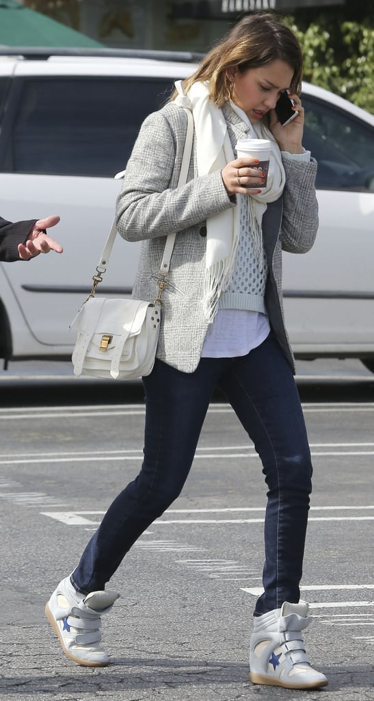 Jessica accessorized her neutral LA ensemble, including dark skinnies, with Isabel Marant sneakers and a mini Proenza Schouler bag.