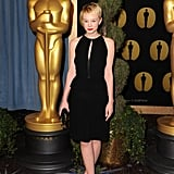 It's no secret Carey loves a classic LBD, but at an Academy Awards Luncheon, the actress updated the closet staple with a front peek-a-boo keyhole and peplum detail.