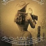 Girl With a Gun: An Annie Oakley Mystery by Kari Bovée