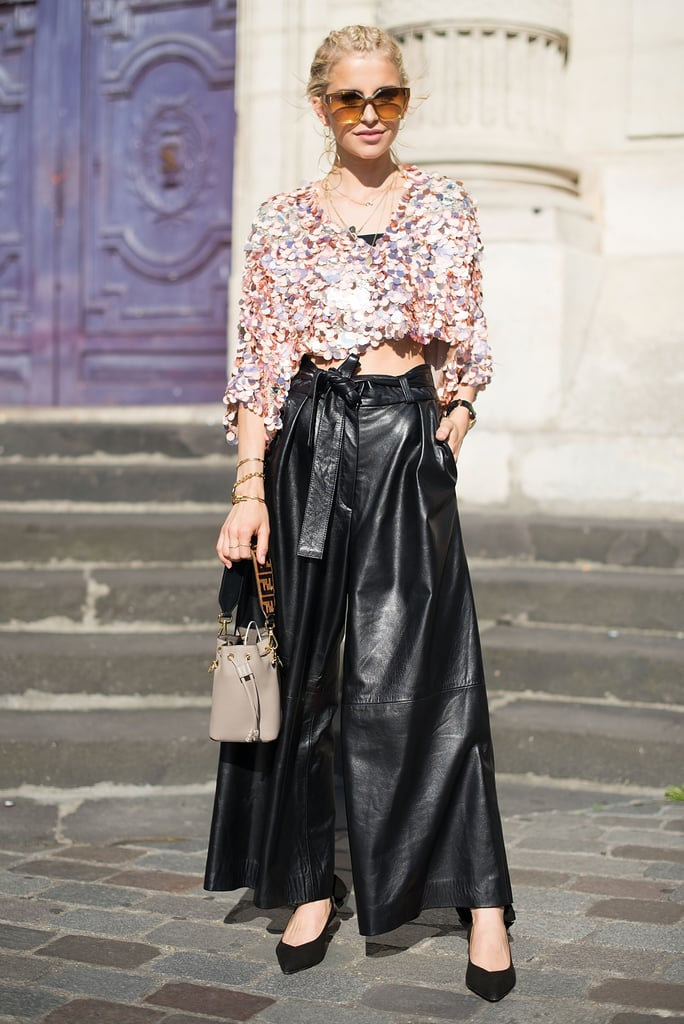 One of our favorite looks spotted in Paris was this sequin top and knotted leather pants combo.