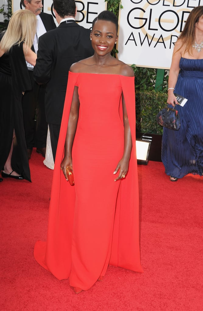 Lupita Nyong'o was the lady in red when she arrived at the 2014 Golden Globe Awards in LA in a Ralph Lauren number. She is nominated for the best supporting actress for her role in 12 Years a Slave, which, interestingly enough, is also her first film role. Despite not having a long film resume, Lupita does come to the Globes with impressive credentials as she is a graduate of Yale's famed School of Drama's Acting program. Hopefully all the attention on Lupita will carry over on Thursday when the Oscar nominations are announced. Lupita is expected to land a nod for her role in 12 Years a Slave alongside her co-stars Michael Fassbender and Chiwetel Ejiofar.