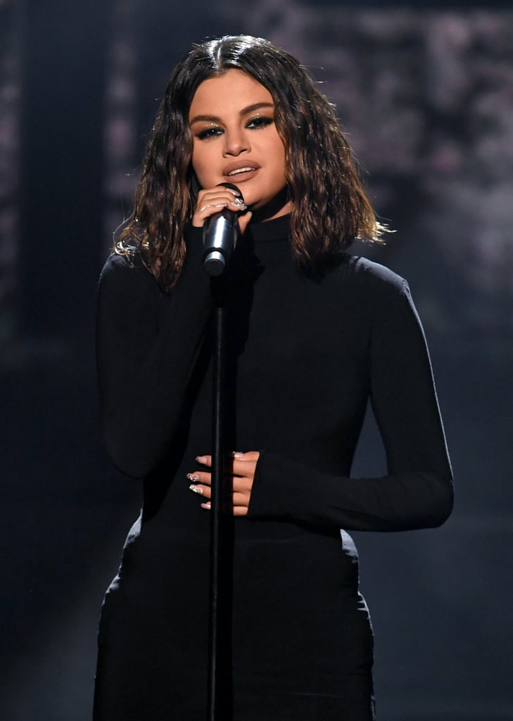 "Selena Gomez made a triumphant return to the American Music Awards in LA on Sunday. After steaming up the red carpet in a highlighter-green Versace dress, the 27-year-old singer took the AMAs stage for the first time in two years for the television premiere of her new singles. Gomez started things off on an emotional note as  she belted out ""Lose You to Love Me"" in a black gown before switching into a sparkly leotard and getting down to ""Look at Her Now."" Gomez released both tracks in October, and ""Lose You to Love Me"" is actually Gomez's first song to ever hit No. 1 on the Billboard Hot 100 chart. ""This song was inspired by many things that have happened in my life since releasing my last album,"" Gomez previously said about the Justin Bieber-inspired single. ""I want people to feel hope and to know you will come out the other side stronger and a better version of yourself."" Check out Gomez's performance above."