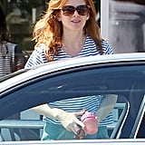 Isla Fisher got into the car after having breakfast with husband Sacha Baron Cohen.