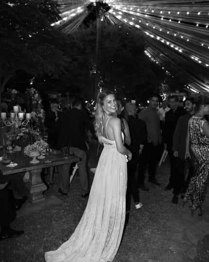 """Married in Chloé – Bar Refaeli wore our custom-made flou dress at her wedding in Israel, fitted and finished with the Maison's distinct touch of couture savoir-faire #chloeGIRLS,"" Choé wrote on Instagram."