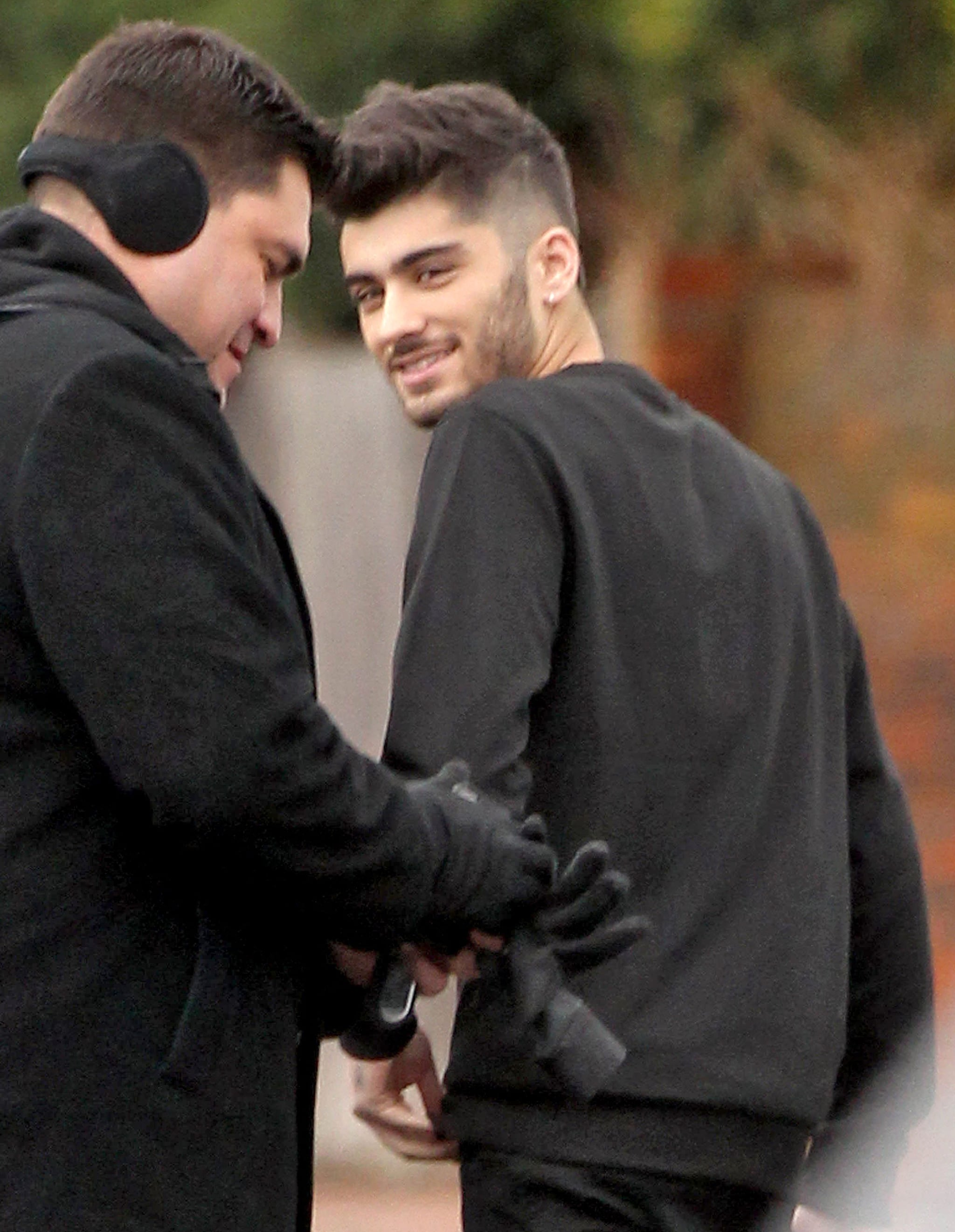 Zayn gave a smirk during the outing with his band.