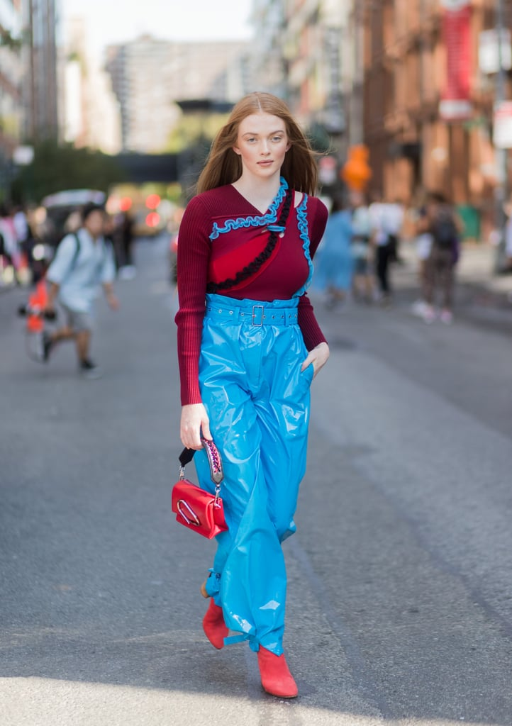 7e2ab82adf7 This Model Wore a Burgundy Sweater With Bright Blue Paperbag-Waist Pants