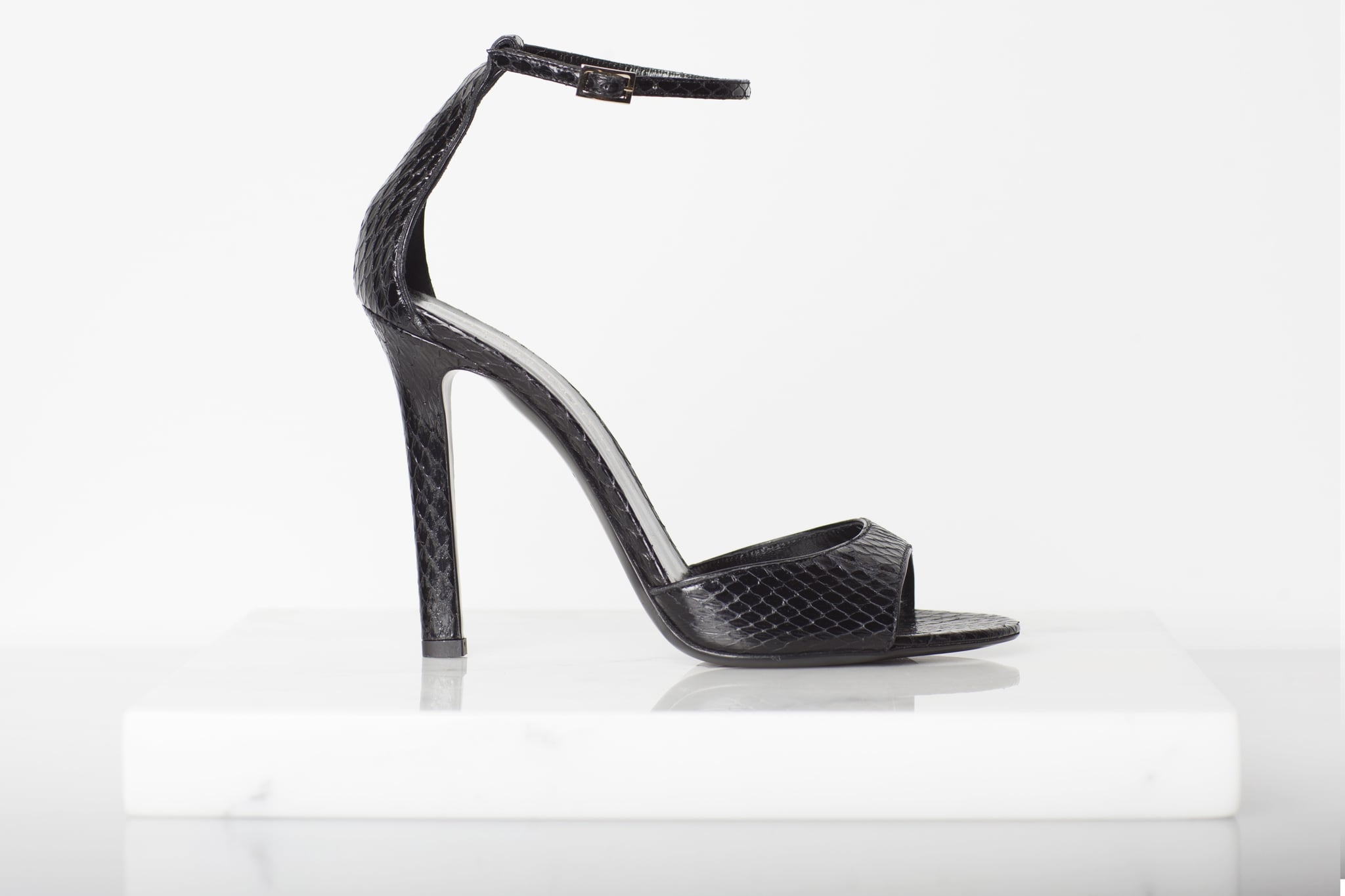 Whisper Watersnake Sandal in Black ($695) Photo courtesy of Tamara Mellon