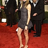Short, sweet, and supersexy in a minidress and a hot red lip at the Golden Globes in '03.