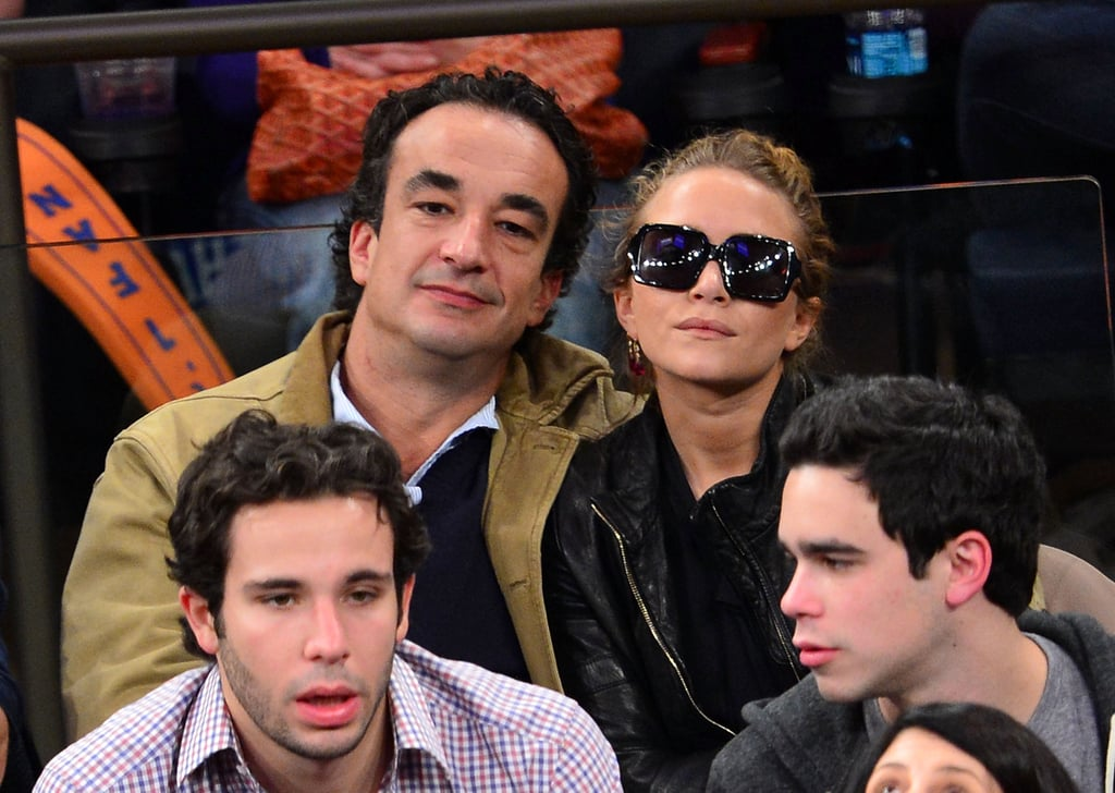 Mary-Kate Olsen wore sunglasses while out with her boyfriend, Olivier Sarkozy, in NYC.