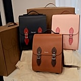 Pictured are the bags gifted by Liverpool's Leather Satchel Company for each of the children, Prince George, Princess Charlotte, and Prince Louis.