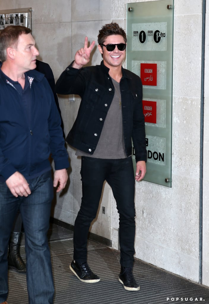 On Thursday, Zac Efron flashed a peace sign while walking around London.