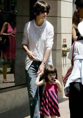 Katie and Suri Stride Down the Sidewalk