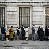 People lined up in London to add their condolences to a card at the South African High Commission in Trafalgar Square.