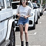 Lucy Hale's romantic top is a perfect foil for street-chic cutoffs.