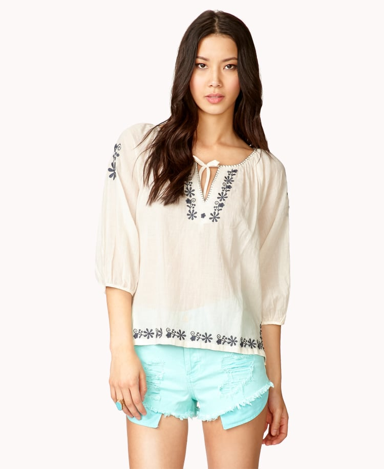 Peasant blouses just scream Summer; we're loving this Forever 21 Floral Embroidered Top ($20).