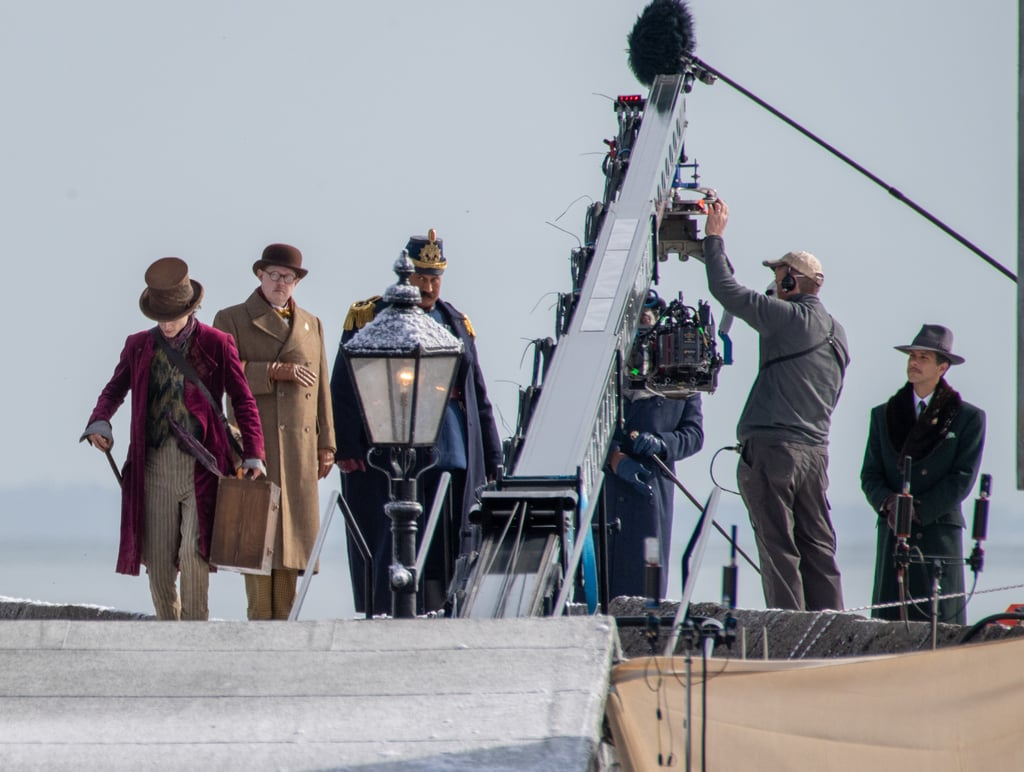 Last but most certainly not least, Timothée has a brown top hat and simple wooden walking stick with a bronze handle.