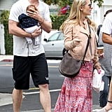 Chris Hemsworth carried India as he and wife Elsa Pataky left a restaurant with friends.