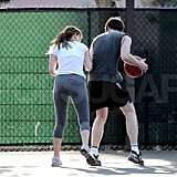 Nicholas boxed Jen out on the court.