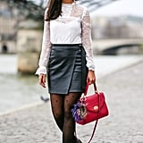 With a White Sheer Top, a Leather Skirt, and Flats