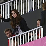 Kate Middleton waved from the stands at the women's hockey semifinal between Argentina and Britain.
