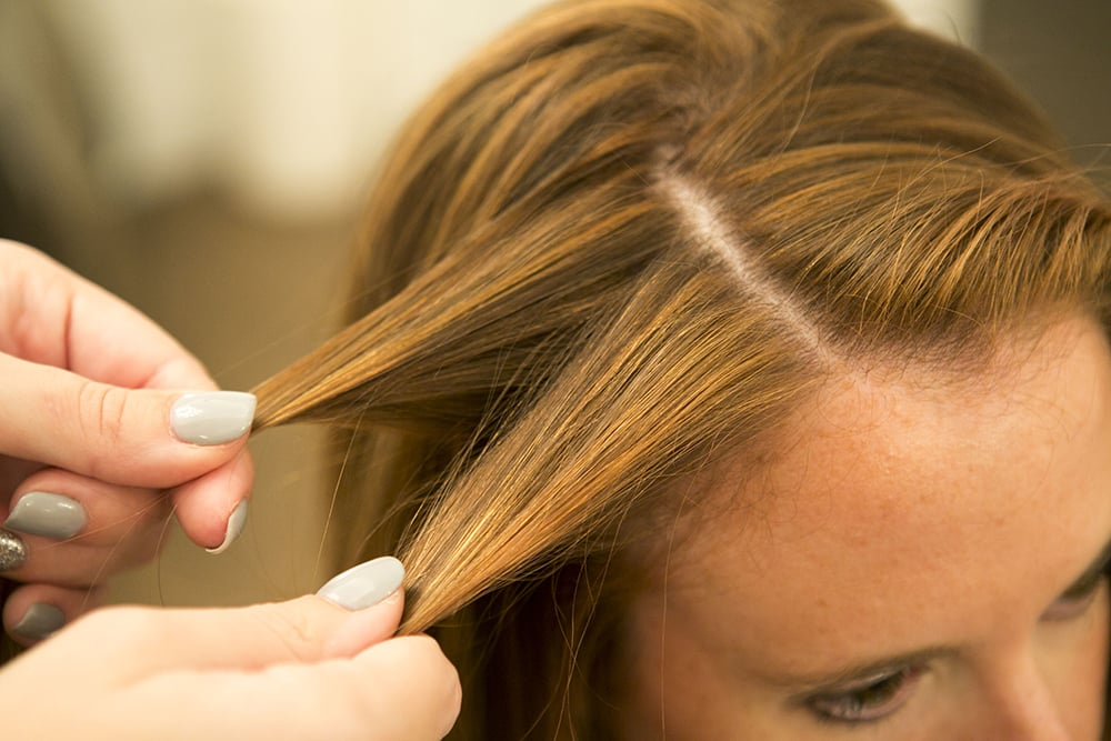 To start your waterfall twist, take two sections of hair.